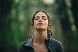 Young beautiful woman exercise mindfulness in the dense Seattle urban forest 7daysPresent TM logo - 7 days Present - mindfulness and meditation experiences - seven days present - AirBnB experiences - 7days present - uplifting - positive - mindful - self-development -practice - inner peace and harmony - lessons